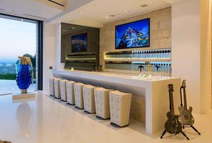 Modern Bar with Quartz floor, simple marble floors, Original grenade sculpture by k-tee, Built-in bookshelf