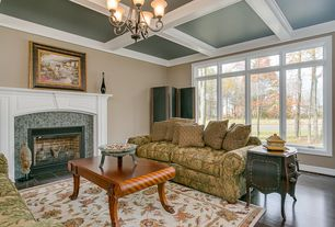 Traditional Living Room with Chandelier, Box ceiling, Crown molding, stone fireplace, Hardwood floors
