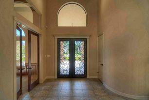 Traditional Entryway with Glass panel door, Concrete tile , six panel door, High ceiling