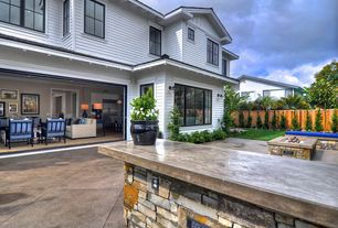 Traditional Patio with exterior concrete tile floors, Casement, picture window, Fire pit, Pathway, Fence, French doors