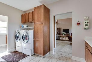 Traditional Laundry Room with Built-in bookshelf, Standard height, Undermount sink, sandstone tile floors, Drying Rack