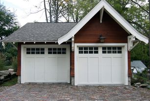 Craftsman Garage with Brick floors, High ceiling, Barn door, Wall sconce