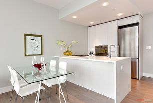 Contemporary Kitchen with Breakfast nook, Flush, Galley, Bamboo floors, European Cabinets, Waterfall countertop