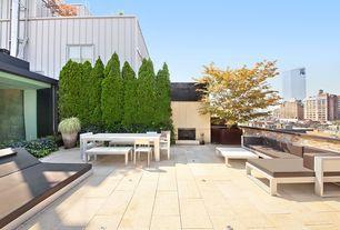 Contemporary Patio with exterior concrete tile floors, Deck Railing, Casement, exterior tile floors, Fence