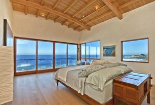Contemporary Master Bedroom with High ceiling, Exposed beam, Hardwood floors, MAGNARP Floor lamp, natural