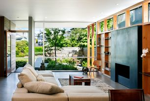Contemporary Living Room with specialty window, other fireplace, can lights, Standard height, Concrete floors, Fireplace