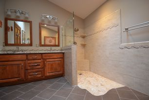 Eclectic Master Bathroom with Master bathroom, slate tile floors, Undermount sink, Ceramic Tile, Raised panel, Double sink