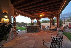 Rustic Patio with outdoor pizza oven, Fence, exterior stone floors