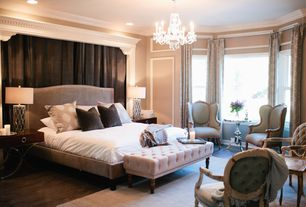 Traditional Master Bedroom with Chandelier, Crown molding, Upholstered tufted bench, Hardwood floors
