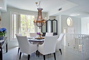 Traditional Dining Room with Standard height, can lights, picture window, Crown molding, Chandelier, Hardwood floors