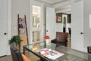 Traditional Home Office with specialty door, Laminate floors, Crown molding
