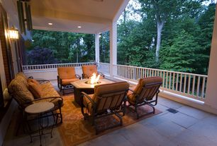 Traditional Porch with Fire pit, exterior tile floors, Wrap around porch