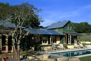 Country Swimming Pool with exterior stone floors, sliding glass door, Raised beds, Pathway, Trellis, Other Pool Type, Fence