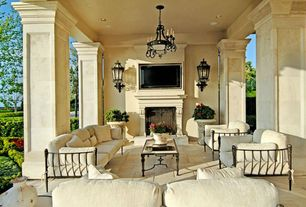 Traditional Porch with Wrap around porch, Covered patio, exterior tile floors, Outdoor fireplace