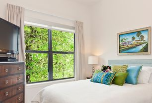 Tropical Guest Bedroom with double-hung window, High ceiling