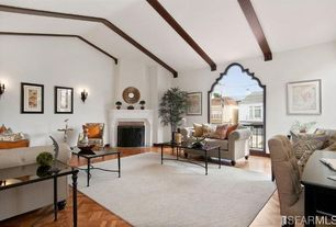 Traditional Living Room with Fireplace, specialty window, metal fireplace, Exposed beam, Hardwood floors, Wall sconce