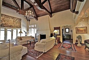 Traditional Great Room with bedroom reading light, French doors, Chandelier, picture window, Fireplace, High ceiling