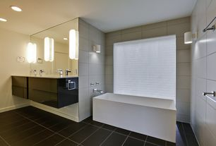 Contemporary Master Bathroom with Wall sconce, Freestanding, European Cabinets, Corian counters, Flush, Double sink