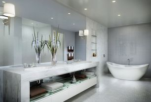 Contemporary Master Bathroom with Undermount sink, Complex marble counters, Concrete tile , Built-in bookshelf, Freestanding