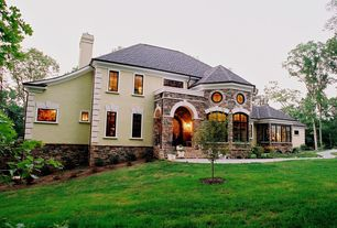 Contemporary Exterior of Home with Pathway, Arched window, Stacked stone