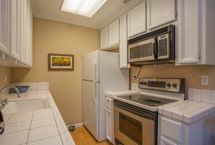 Traditional Kitchen with Hardwood floors, flush light, Inset cabinets, Undermount sink, U-shaped, Flat panel cabinets
