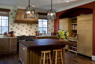 Country Kitchen with Travertine counters, Undermount sink, Wood counters, Custom hood, Pendant light, Breakfast bar, L-shaped