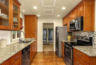 Contemporary Kitchen with Simple granite counters, Flat panel cabinets, Casement, Subway Tile, can lights, dishwasher, Flush