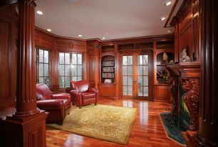 Traditional Living Room with Built-in bookshelf, Hardwood floors, can lights, Standard height, French doors, Columns