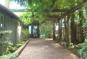 Traditional Landscape/Yard with Fence, Raised beds, exterior stone floors, French doors, Pathway, Trellis