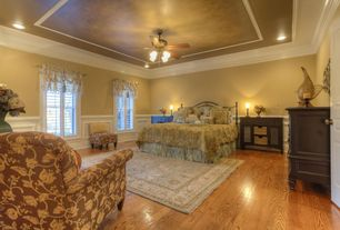 Traditional Master Bedroom with Wainscotting, specialty door, Ceiling fan, Hardwood floors, Crown molding