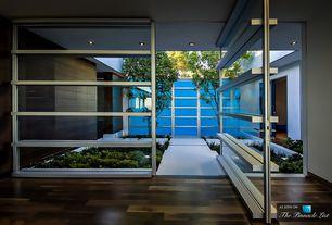 Modern Entryway with Hardwood floors, Built-in bookshelf, French doors