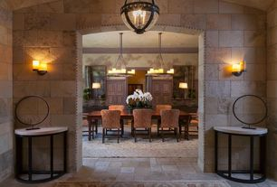 Mediterranean Dining Room with Crown molding, Wainscotting, limestone tile floors, interior wallpaper