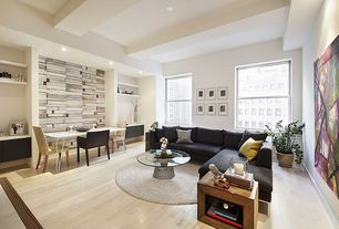 Contemporary Living Room with Round white rug, Tribecca home ariana sectional, Built-in bookshelf, Laminate floors