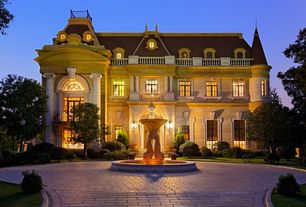Traditional Exterior of Home with Water fountain, French windows, Arch window, Round about driveway, Balcony