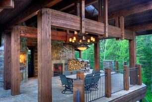 Rustic Porch with Deck Railing, Outdoor kitchen, Wrap around porch, exterior stone floors, outdoor pizza oven