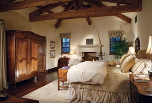 Rustic Master Bedroom with Exposed beam, 18th-C. French Armoire, Hardwood floors, Cement fireplace, Built-in bookshelf