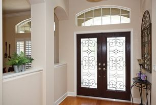 Traditional Entryway with Laminate floors, Cathedral ceiling, Casement, Glass panel door, Transom window, Columns