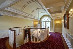 Traditional Hallway with Chandelier, Carpet, bedroom reading light, Bamboo floors, Standard height, Wainscotting, Columns