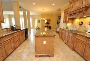 Traditional Kitchen with Breakfast nook, Undermount sink, Concrete tile , Pendant light, Simple granite counters, Galley