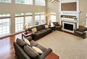 Contemporary Living Room with Ceiling fan, High ceiling, Arched window, flush light, Laminate floors, Carpet