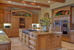 Mediterranean Kitchen with Raised panel, Built-in bookshelf, Undermount sink, Sunflowers, Arched doorway, Oak cabinets