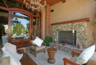 Modern Porch with exterior tile floors, River rock fireplace