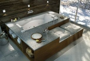 Contemporary Master Bathroom with specialty window, stone tile floors, Master bathroom, drop in bathtub, Bathtub, Wall sconce