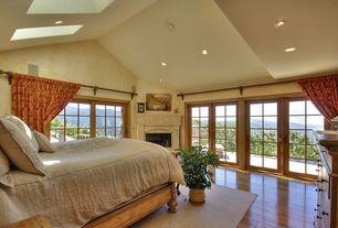 Mediterranean Master Bedroom with French doors, Built-in bookshelf, Cathedral ceiling, Hardwood floors, Skylight