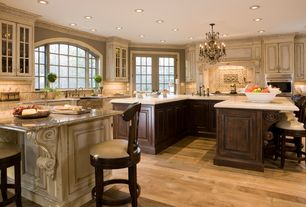Traditional Kitchen with Simple granite counters, Kitchen island, Standard height, Farmhouse sink, French doors, wall oven