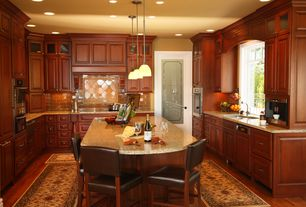 Traditional Kitchen with Complex granite counters, U-shaped, Pendant light, Glass panel door, Raised panel, Undermount sink