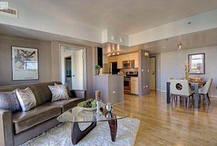 Modern Great Room with Standard height, Noguchi table, Paint 2, West elm darby wool shag rug, Hardwood floors, Paint 1