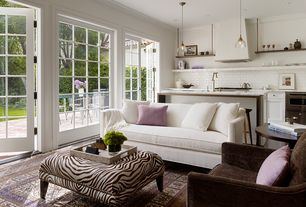 Contemporary Living Room with Carpet, Pendant light, Built-in bookshelf, French doors, Crown molding, interior brick