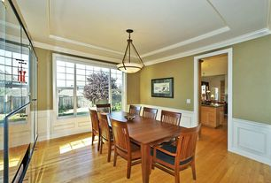 Traditional Dining Room with Box ceiling, Hardwood floors, Crown molding, flush light