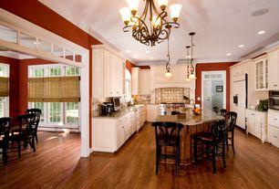 Mediterranean Kitchen with Raised panel, U-shaped, Breakfast bar, Arched window, Custom hood, Chandelier, Limestone Tile